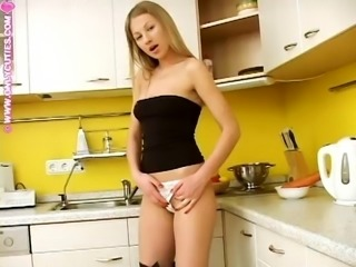 Kinky blonde Adelina loves masturbating in a kitchen