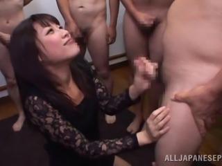 Enticing Asian MILF giving a sensual handjob in gangbang before being smashed...
