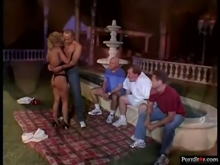 Vintage blonde Sammie Sparks gives perfect blowjob in public