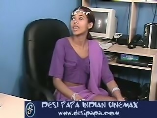 Attractive Indian chick giving hot blowjob in the office