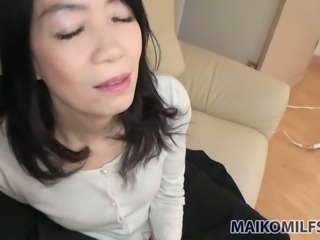 Nice Japanese MILF Yukiko Asaba has nothing against wanking some dick