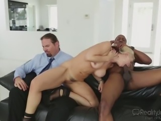 Sexy babe fucks a well equipped man right in front of her cuckold hubby