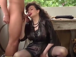 Brunette majestic milf blows dick on the balcony and fucks on the table
