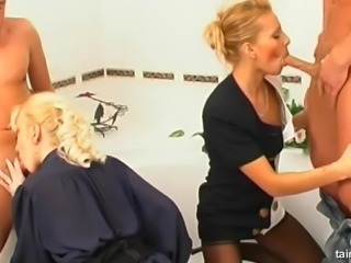 Two fully clothed blondes taking two cocks in their wet pussies