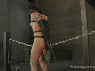 Brunette submissive lady is tortured with ropes and devices