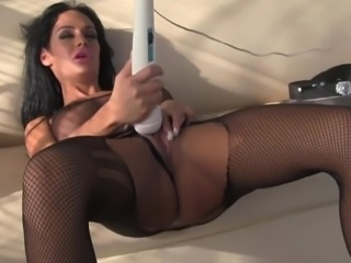Angelina Valentine enjoys a buzzing toy between her legs