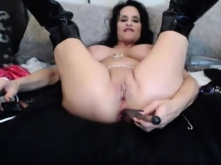 Squirting mature celebrity with huge boobs