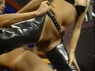 Magnificent brunette in black latex rides on a big dick