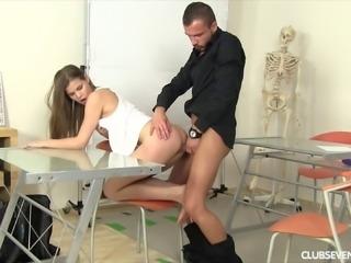 Teen and her teacher fucking over a desk in class