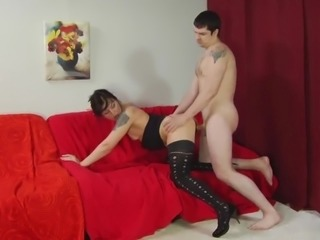 Randy MILF gets pounded by a youn stud on the sofa