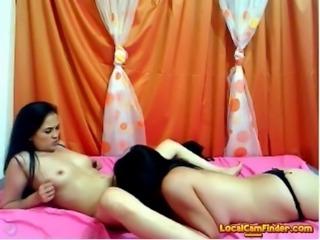 Slutty brunette lesbian girls enjoyed fingering pussy on live cam