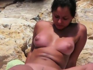 Teen flashing big boobs on windy beach