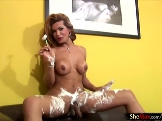 Sexy babe with a cock shaves her legs and gets frisky