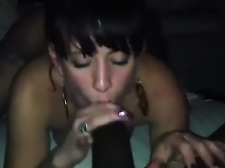 Big brunette gives handjob to hard cock