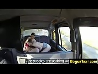 Lesbian taxi babes scissoring in backseat