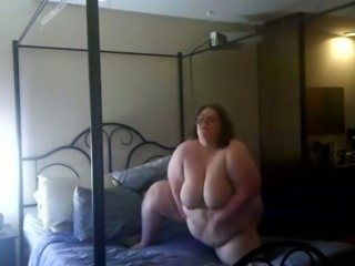 Extremely playful BBW with huge belly masturbates in bedroom