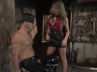a hot bondage scene with a sexy blonde shemale