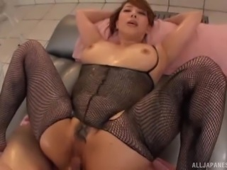 Squeezing the large tits of Kazama Yumi as she is on top of him