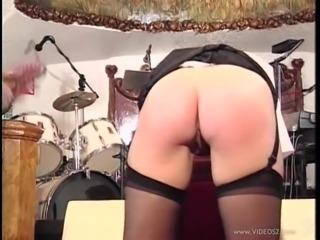 Kinky slut wearing stockings gets her butt spanked hard
