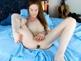 Beautiful young shemale drills her aching ass with a dildo