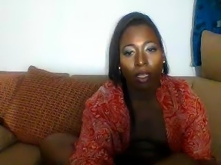 Curvy black shemale jerks off her meat pole on the couch