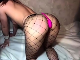 Sexy brunette in fishnet pantyhose gets drilled doggystyle