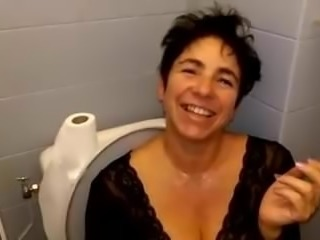 A hot milf  get piss on in toilet