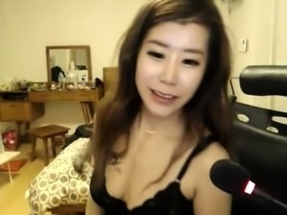 Enticing Korean camgirl in lingerie flashes her hot curves
