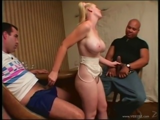 Busty blonde babe gets cum on her face after milking two cocks i a hot...