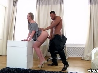 White long legged blondie blows big black dick of a young man