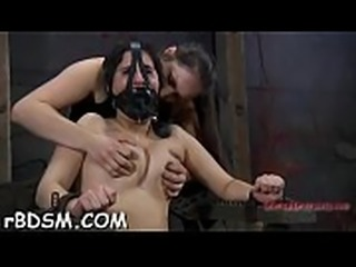 Tied up chick gets her pink flaps opened up for lusty punishment