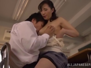 Dirty Asian cougar with perky tits sucking a stranger's cock