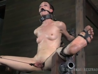 Slave girl with her legs spread wide gets her cunt stretched and toyed