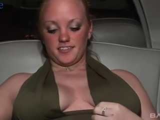 Lewd real whore in light pink stuff masturbates herself in the limo