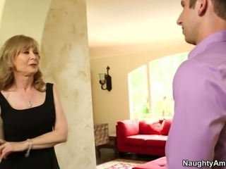 Mature woman Nina Hartley is blowing young studs dick deepthroat