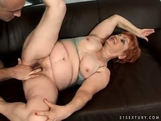 Playful redhead granny is fucked hard in provocating porn video