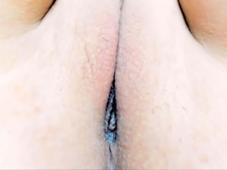 Striking camgirl drives a dildo in and out of her tight cunt