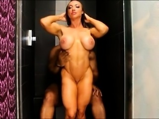 Bodacious brunette milf fucks a big black cock in the shower