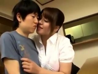 Big breasted Japanese milf takes advantage of a young cock