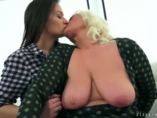 Spoiled granny is having her hairy pussy eaten out by kinky young slut